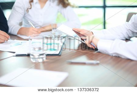 Business adviser analyzing financial figures denoting the progress in the work of the company