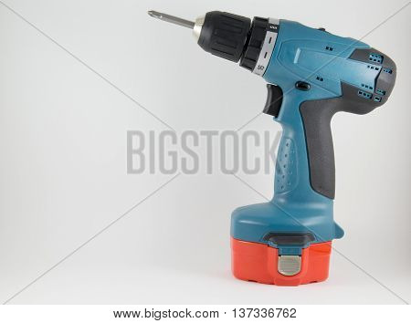 Cordless screwdriver with a Phillips on a white background