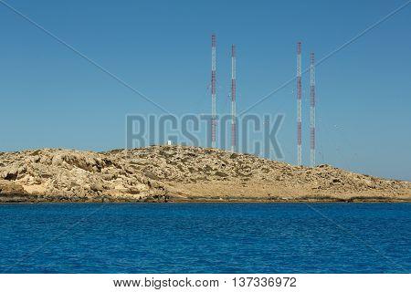 Small lagoon with cyan water in Kavo Greco area near Ayia Napa city on Cyprus island