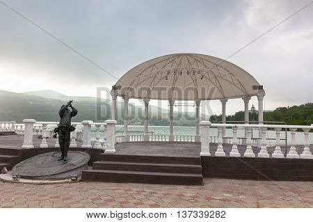 ABRAU-DURSO, RUSSIA - MAY 14, 2016: Pavilion and monument on the shore of Lake Abrau, Russia and a monument on the shore of Lake Abrau. Abrau-Dyurso is the center of Russia's most important wine-growing region