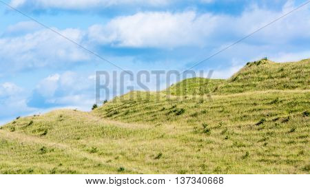 Ramparts of Iron Age fort on Battlesbury Hill, Wiltshire, UK. Ancient defensive construction on hillside on the edge of Salisbury Plain near Warminster England