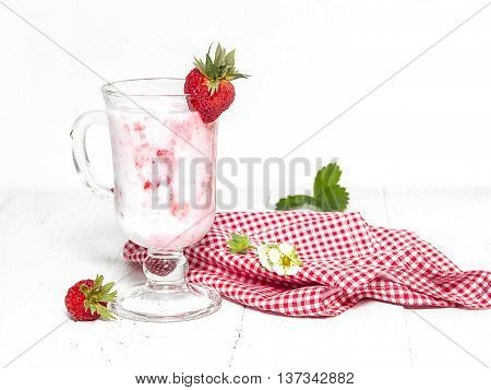Yogurt with strawberries. Tasty useful delicacy- kefir