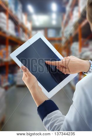 Businesswoman checking inventory in market on tablet computer