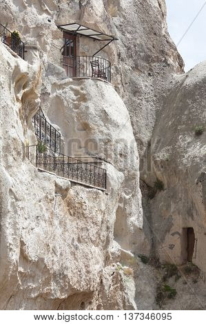 Rugged rock formations riddled with cave houses near Goreme Cappadocia Turkey. Close up