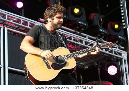 NASHVILLE-JUL 11: Country recording artist Thomas Rhett performs during Luke Bryan's 'Kick The Dust Up' Tour at Vanderbilt Stadium on July 11, 2015 in Nashville, Tennessee.