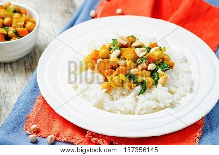 Sweet potato spinach chickpea curry with rice.