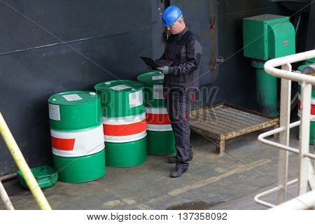 Industrial worker inspecting the facilities of a plant.