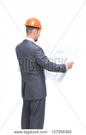 Confident engeneer in formalwear and hardhat examining blueprint isolated on white baskground