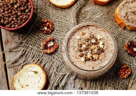 Mushrooms walnuts green lentil pate on wooden background