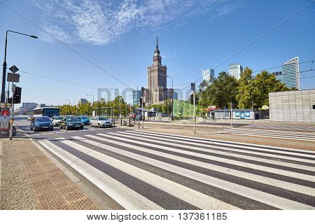 Warsaw Poland - 26 June 2016: Pedestrian crossing in front of the Palace of Culture and Science best known city landmark.