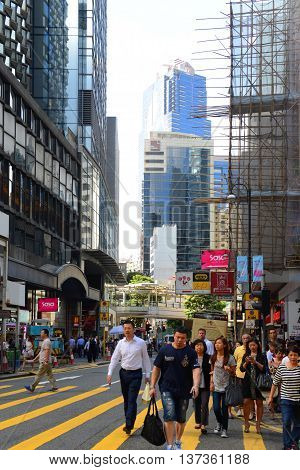 HONG KONG - NOV 9: Queen's Road Central near Pottinger Street on Nov 9, 2015 in Hong Kong Island, Hong Kong.
