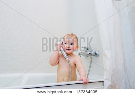 The little girl playing in the bathroom