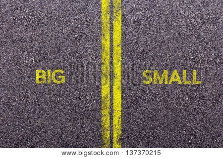 Tarmac With The Words Big And Small