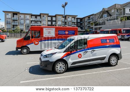 VANCOUVER CANADA - June 12 2016: Canada Post truck and van on a parking lot of a Canada Post central office.