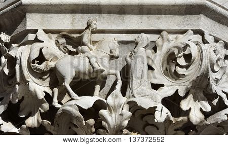 Medieval scene with cavalier and lady, from Doge palace ancient capital, in St Mark Square Venice