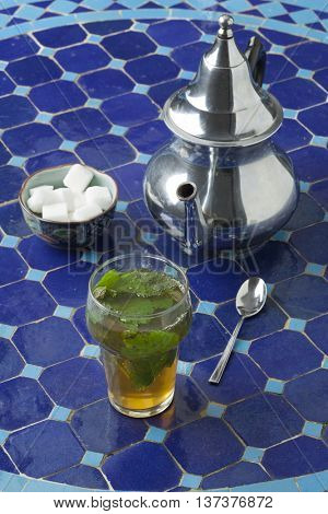 Traditional Moroccan glass of mint tea outdoors