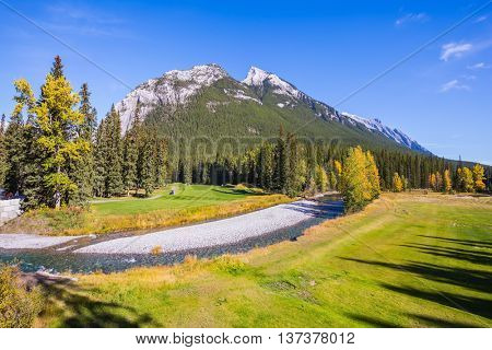 Dry creek in a mountain Banff park. Sunny autumn day in the Canadian Rockies