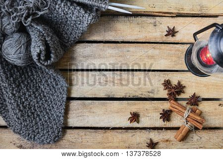 autumn comfort concept still life of candlestick and knitting