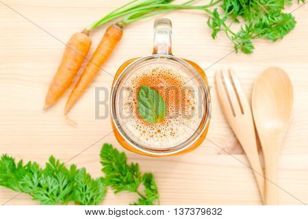 Glasses Of Carrot Juice With Carrot Roots On Wooden Background.glasses Of Tasty Fresh Carrot Juice.c