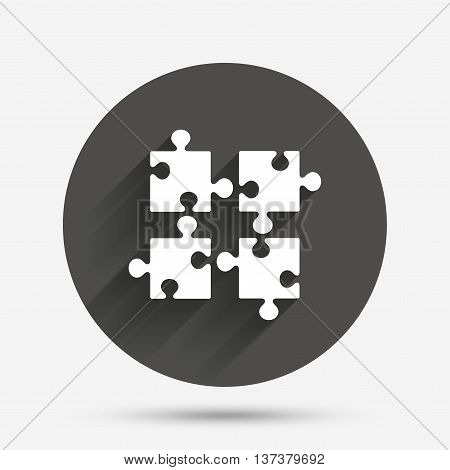 Puzzles pieces sign icon. Strategy symbol. Ingenuity test game. Circle flat button with shadow. Vector