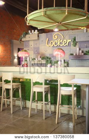 MOSCOW - JUN 10, 2015: Interior Locker Quest Bar with bar table and chairs