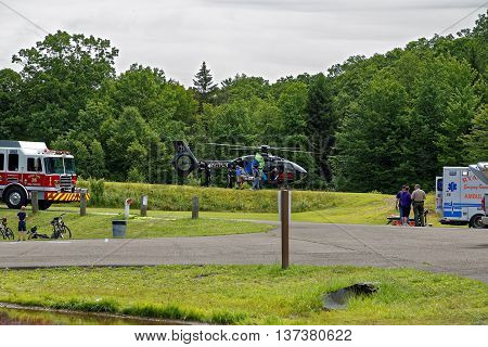 BARNESVILLE PA- JULY 3 2016: A medical helicopter flies into Locust Lake State Park to transport a person needing emergency health care.