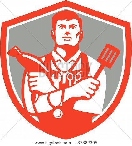 Illustration of a jack of all trades holding a blow dryer and spatula with stethoscope on neck and spanner and barber scissors in apron facing front set inside shield crest on isolated background done in retro style.