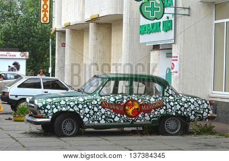 Exterior of the vintage Soviet car GAZ-21 Volga with folk stile tuning. July 6, 2016 in Kiev, Ukraine