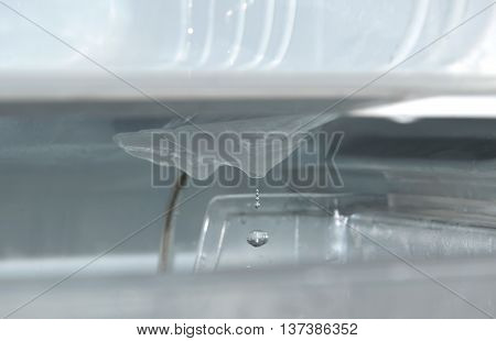 water drop from ice in refrigerator while defrost and cleaning