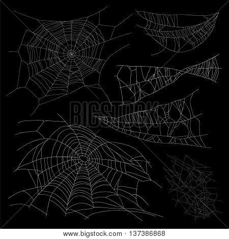 Set of different spiderwebs on a black background. Vector illustration. Elements for design.
