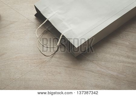 Empty Paper bag on a wooden under sunlight