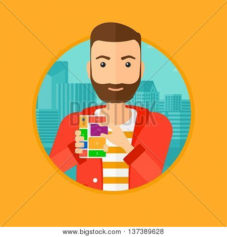 A hipster man with the beard holding modular phone. Young man with modular phone on a city background. Man using modular phone. Vector flat design illustration in the circle isolated on background.