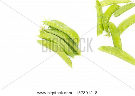Sugar Pea,fresh green peas, Sweet Ion white background, and soft-focus background. select focus front nuts.