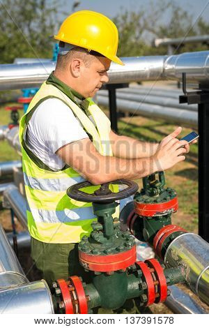 Worker produce oil on the oil plant