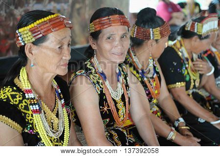 Sipitang Sabah Malaysia - Aug 30 2014:Murut lady in traditional costume decorated with colorful beads during folklore festival in Sipitang Sabah.Murut is among the largest ethnic group in Sabah interior.