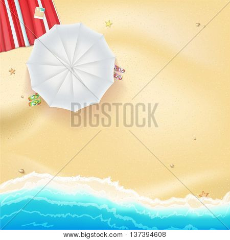Summer travel background. Sunny sandy beach with umbrella, mat and slippers. Tropical seashore with a view of the surf, top view.