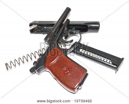 Disassembled handgun on a white background
