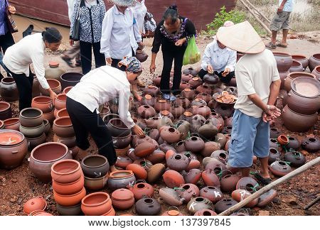 Bac Ninh, Vietnam, April 24, 2016 rural people in Bac Ninh, Vietnam, selling ceramics, Cau River