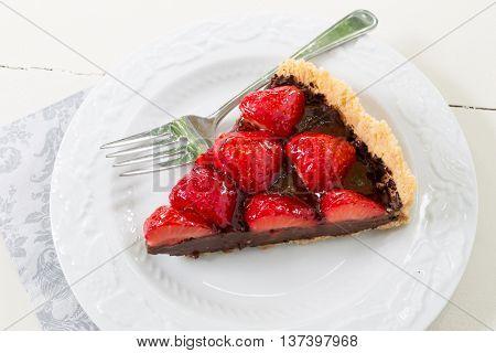 A decadent chocolate strawberry tart.