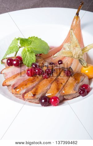Fried and sliced duck meat with cranberries