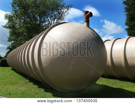 Large waste product receiving tanks ready to install underground in holiday camp site.