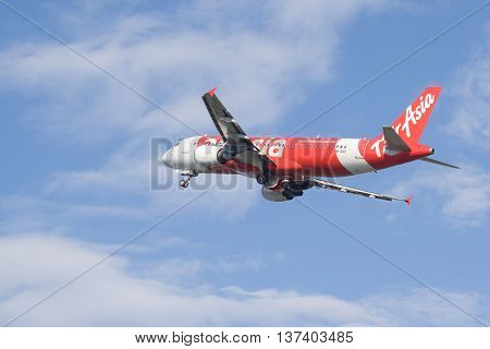 Kota Kinabalu Sabah Malaysia -Feb 22 2016 : Air Asia aircraft taking off from Kota Kinabalu International Airport on . AirAsia Berhad is a Malaysian low-cost airline headquartered in Kuala Lumpur Malaysia.