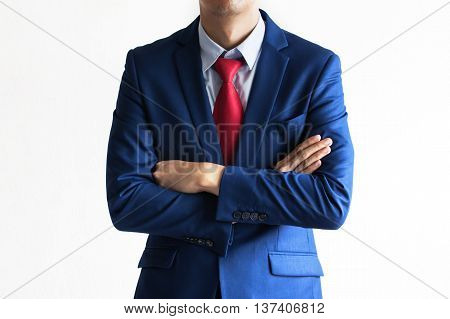 Close Up Of Business Man In The Suit With Arms Fold On The Chest