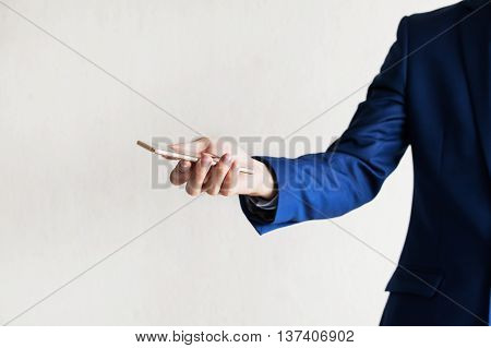 Business Man Using A Cellphone (focus On Phone) With Copy Space