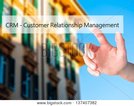 Crm Customer Relationship Management - Hand Pressing A Button On Blurred Background Concept On Visua