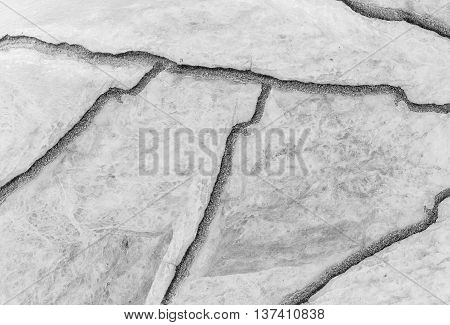 Closeup surface abstract marble pattern at the cracked marble stone floor texture background in black and white tone