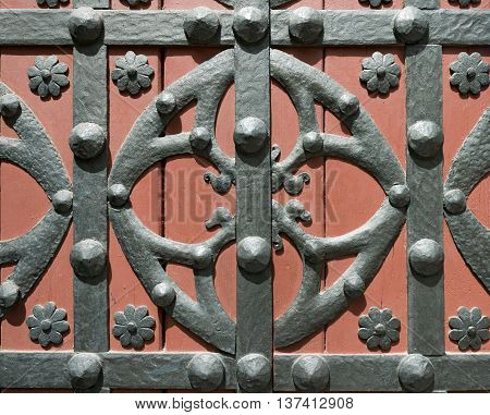 Detail of a old door in wood and wrought iron. Basilica of Santa Maria del Mar in Barcelona Catalonia Spain
