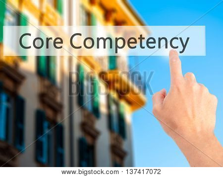 Core Competency - Hand Pressing A Button On Blurred Background Concept On Visual Screen.