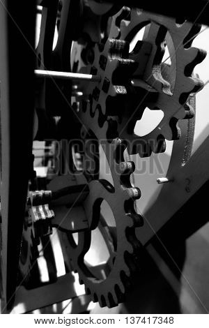 Mechanical metaphor. Souvenir mechanism with gears monochrome stock photo
