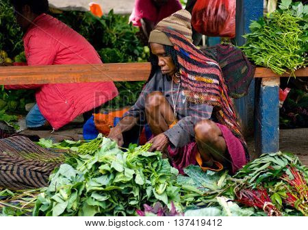 PAPUA PROVINCE INDONESIA -DEC 28: Green vegetable displayed for sale at a local market in Wamenaon New Guinea Island Indonesia on December 28 2010.